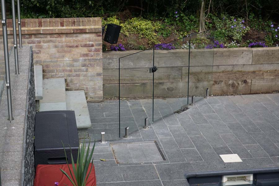 Pool entrance with glass wall and glass gate