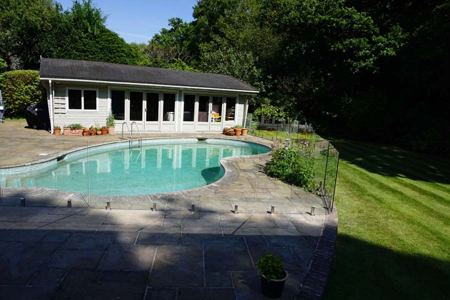 Outdoor pool with glass fencing